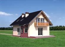 Современный двухэтажный коттедж с темными наличниками на окнах