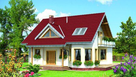 Красивый загородный особняк с эркерами и мансардным этажом