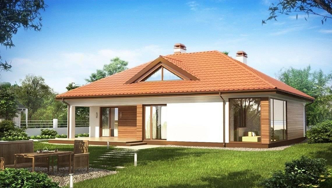 Интересный проект дома с оранжереей и террасой
