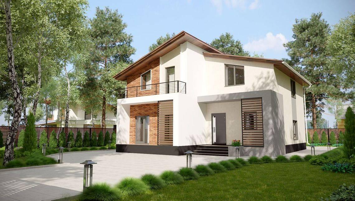 Двухэтажный стильный особняк под крышей сложной формы