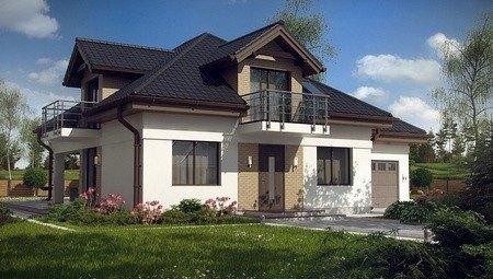 Проект коттеджа с мансардой и большим балконом в традиционном стиле