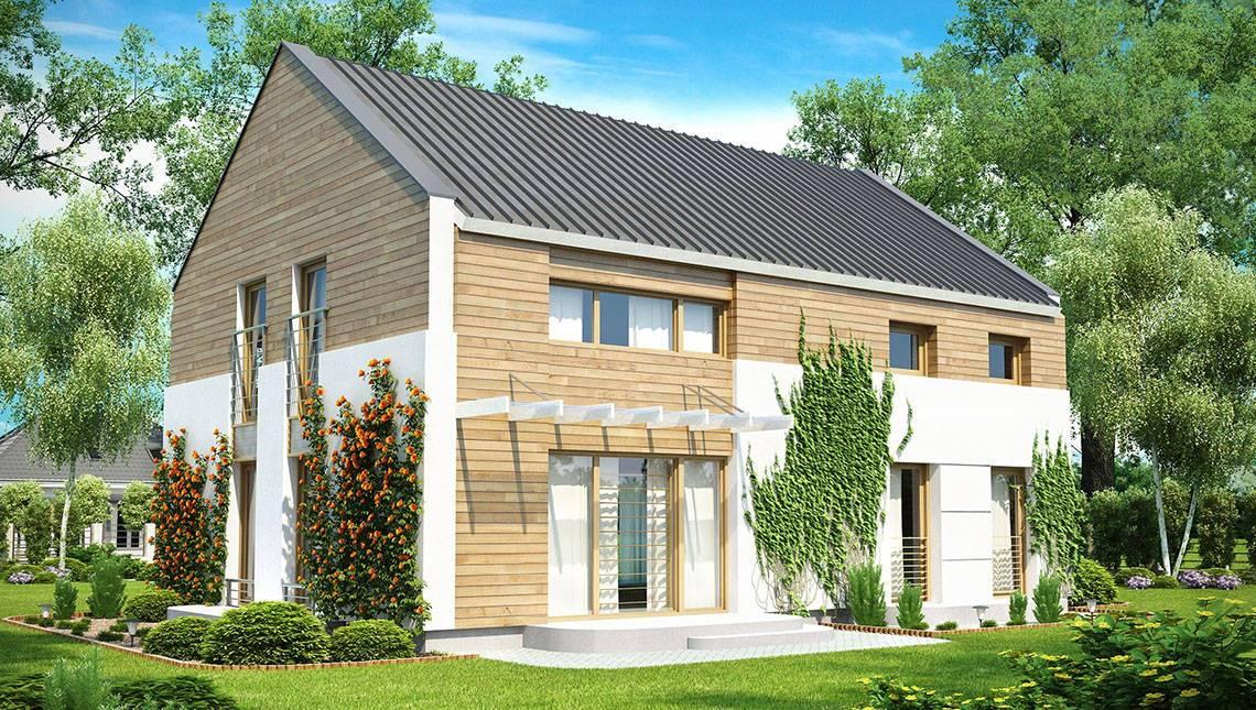 Двухэтажный коттедж с большими окнами и с двускатной крышей