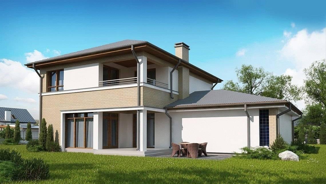Проект классического двухэтажного коттеджа с гаражом на два автомобиля